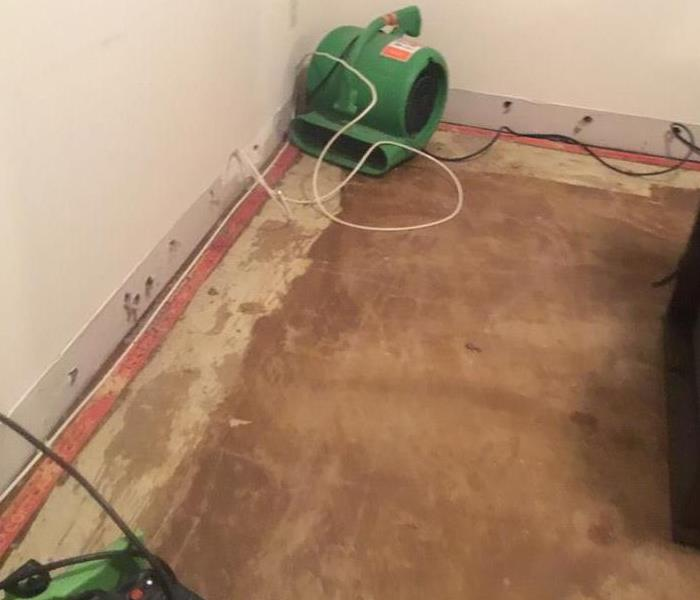 Basement After Mitigation without Carpet and Holes Drilled
