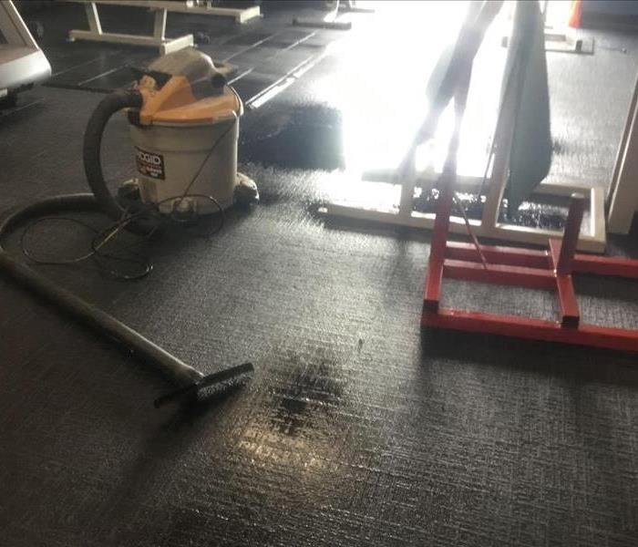 Gym area with saturated carpet