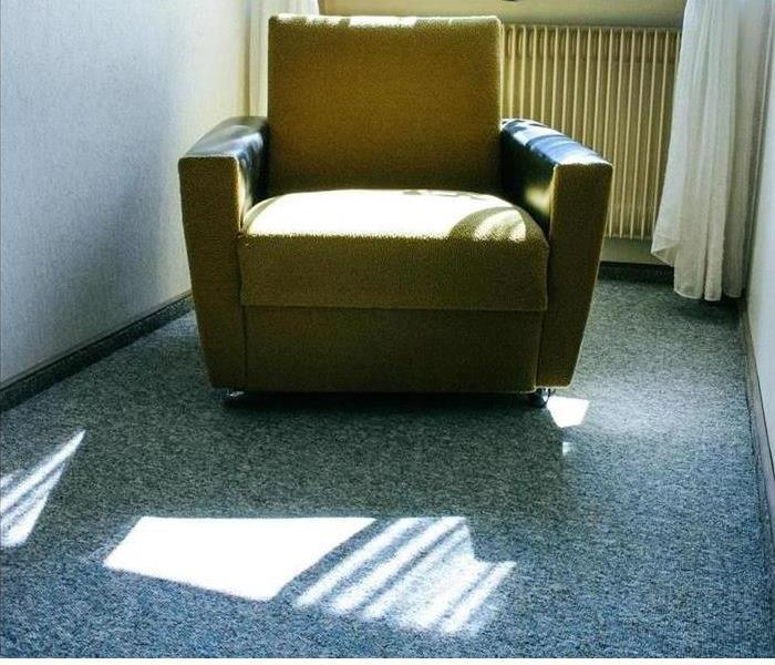 Carpet with chair in front of window